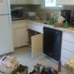 The mess I woke up to Saturday morning... but he pulled it off. New faucet!