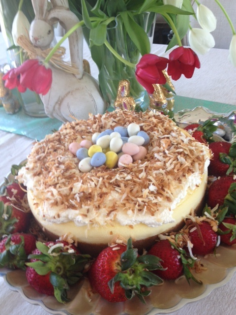 Easy: Buy cheesecake. Spread with whipped cream. Top with toasted coconut. Add Cadbury chocolate eggs. Viola!