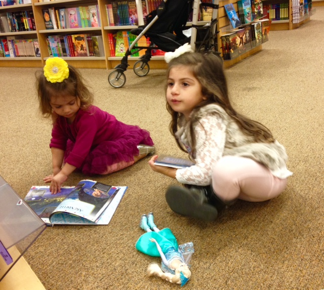 toddler_reading_barnes_and_noble_frozen_books