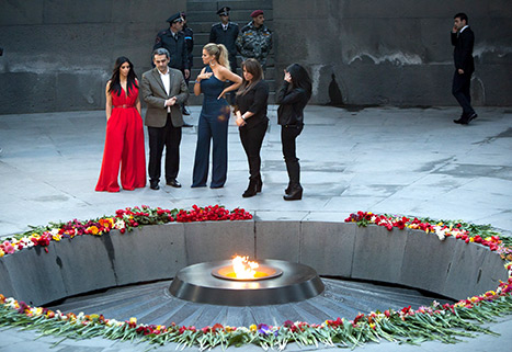 Kim Kardashian, Khloe and their cousins visit memorial for victims of genocide in Yerevan, Armenia. Friday, April 10, 2015. Credit: AP Photo/Hrant Khachatryan, USWeekly.
