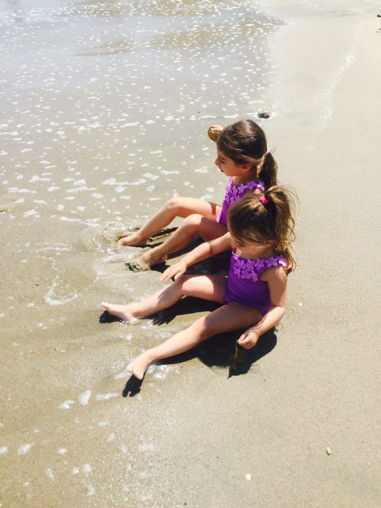 sisters-sand-beach-family-cautious-parenting
