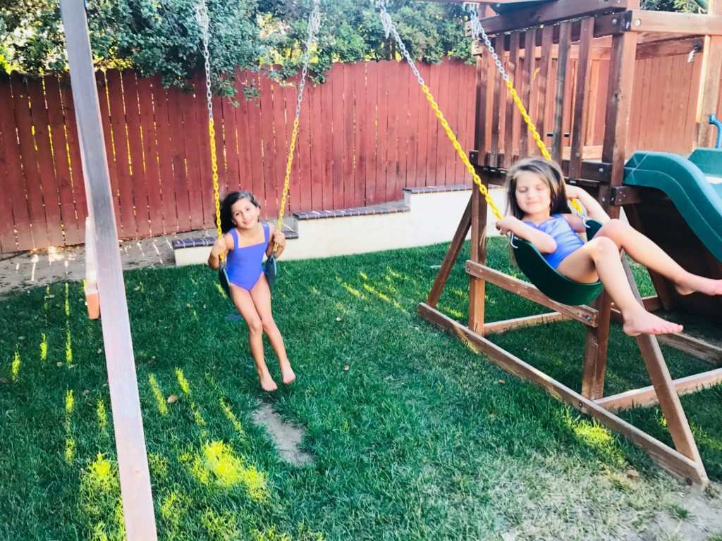 spring-blooms-sisters-daughters-swing-set